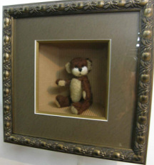 felted teddy in frame